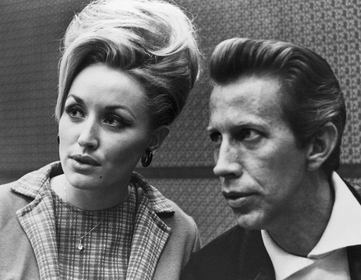 Country singers Dolly Parton and Porter Wagoner in a candid black and white portrait in 1968 in Nashville, Tennessee.