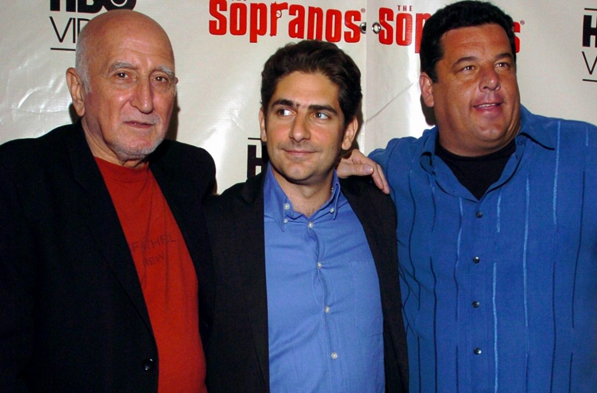 Dominic Chianese, Michael Imperioli, and Steve Schirripa pose together and smile at a 'Sopranos' premiere.