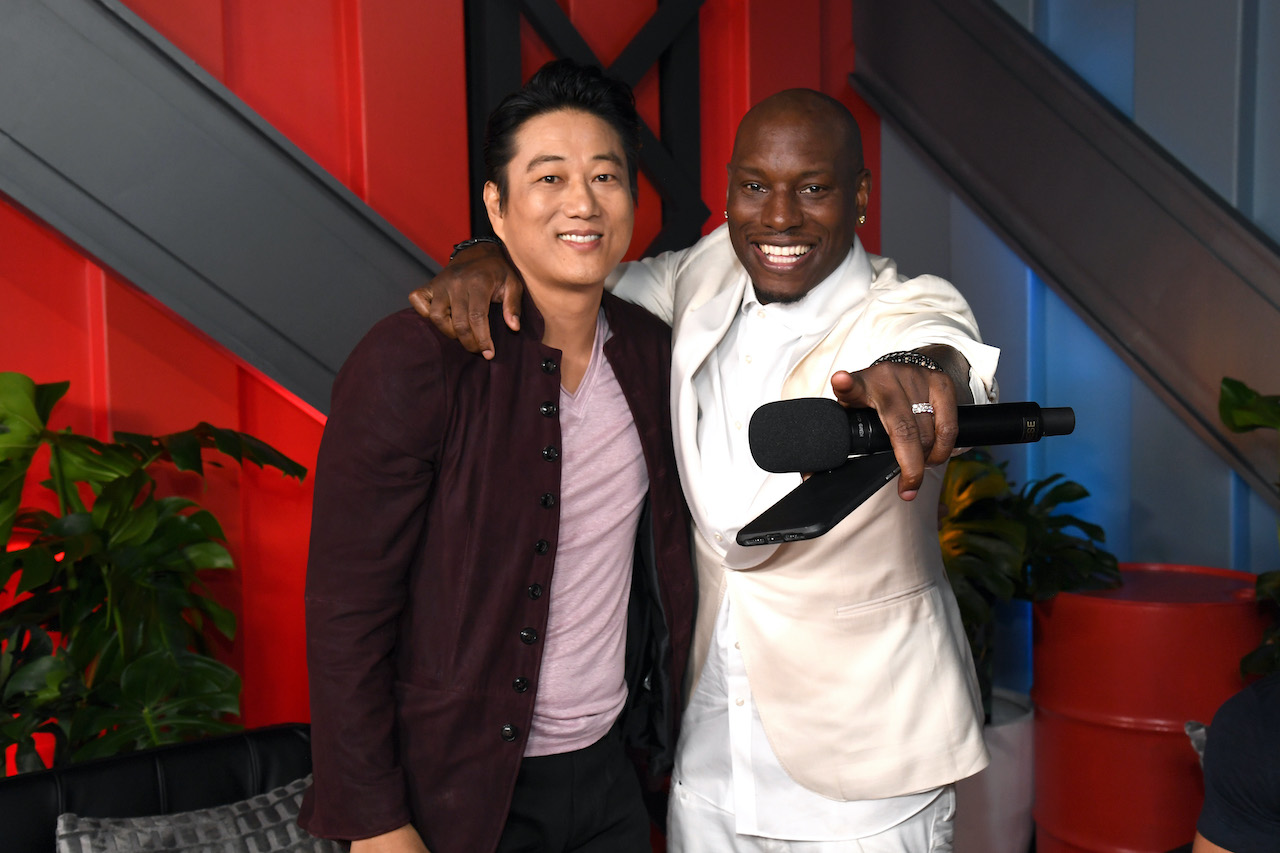 Sung Kang and Tyrese Gibson attend Universal Pictures Presents The Road To F9 Concert and Trailer Drop