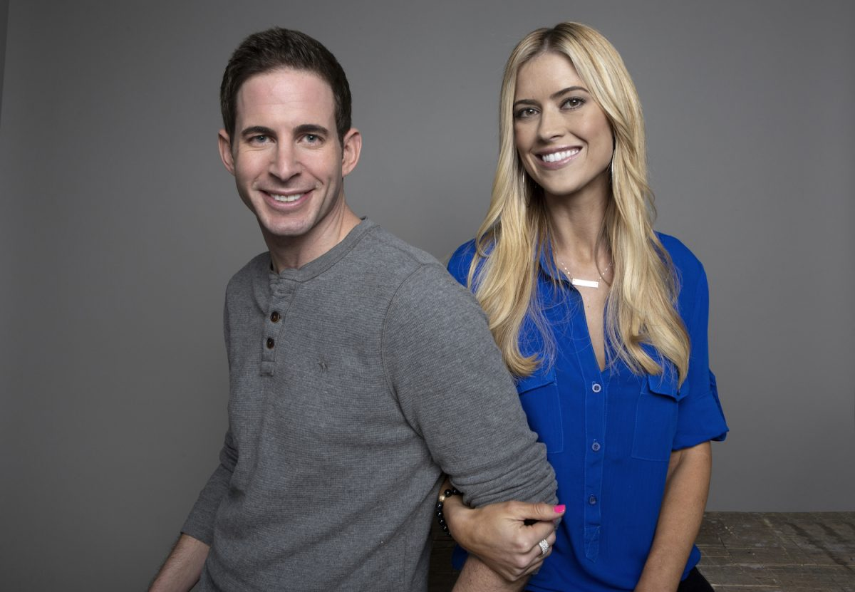 Tarek El Moussa and Christina Haack smiling for a promo still for 'Flip or Flop' in 2017