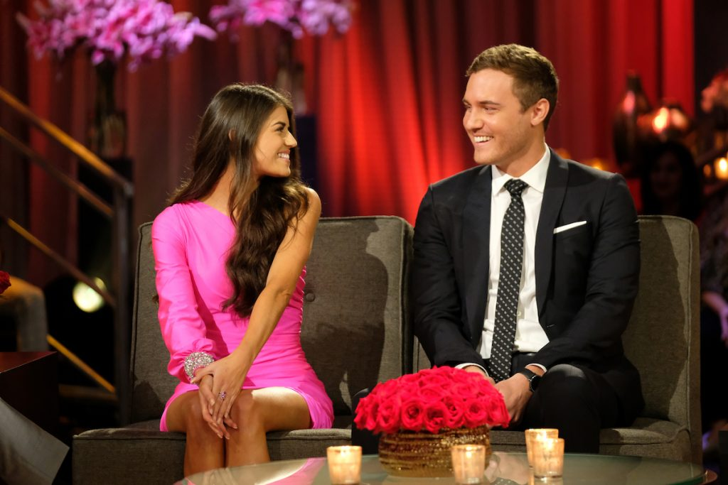 Do the bachelors get paid on 'The Bachelor'? Pictured here is former bachelor Peter Weber with Madison Prewett.