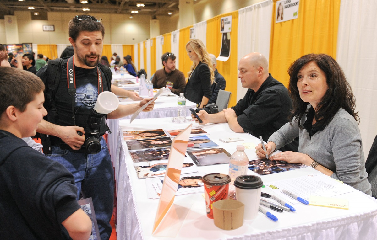 Torri Higginson signs authographs for fans at ComiCon Toronto 2013.