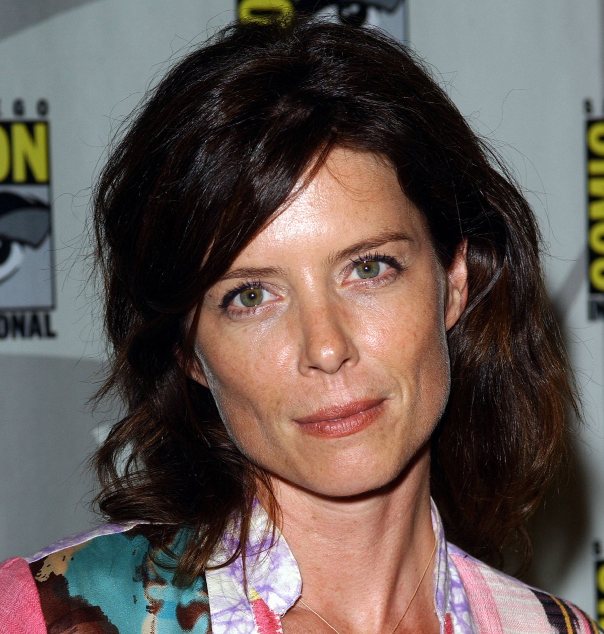 Torri Higginson smiles and poses for a photograph while at an event.
