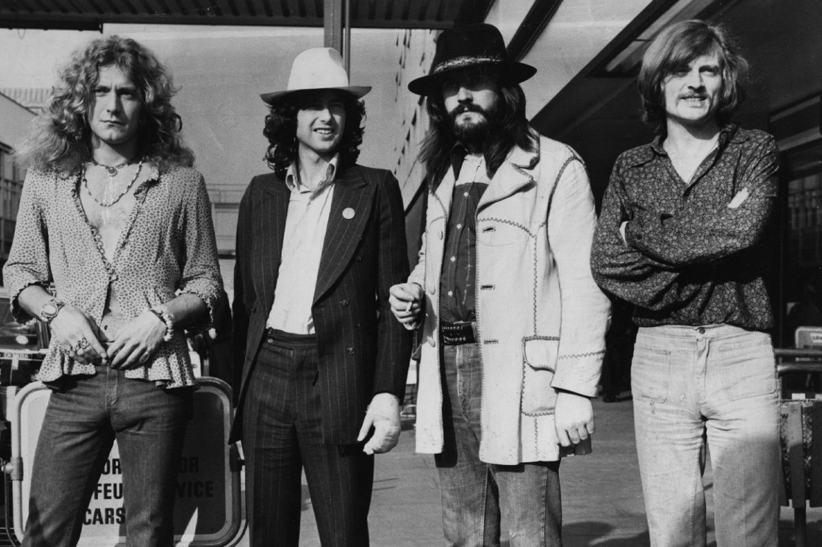The members of Led Zeppelin pose together at an airport, circa '73.