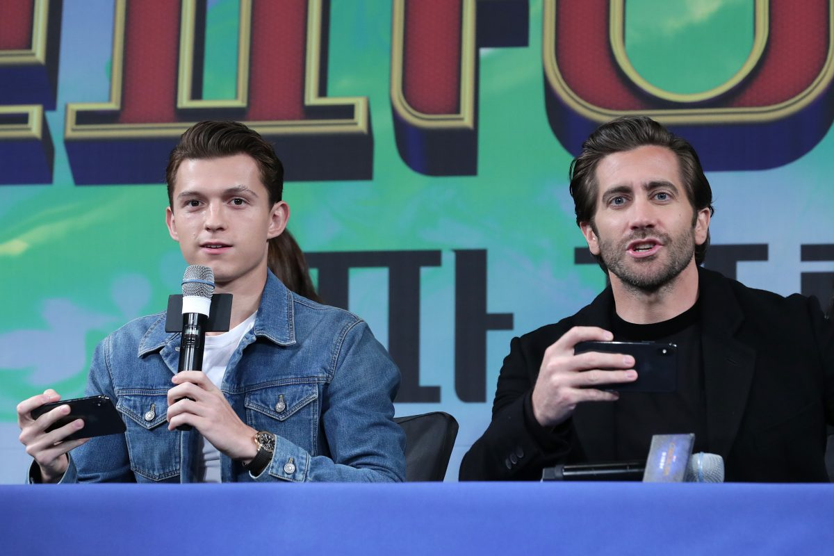 Tom Holland and Jake Gyllenhaal talking at press conference