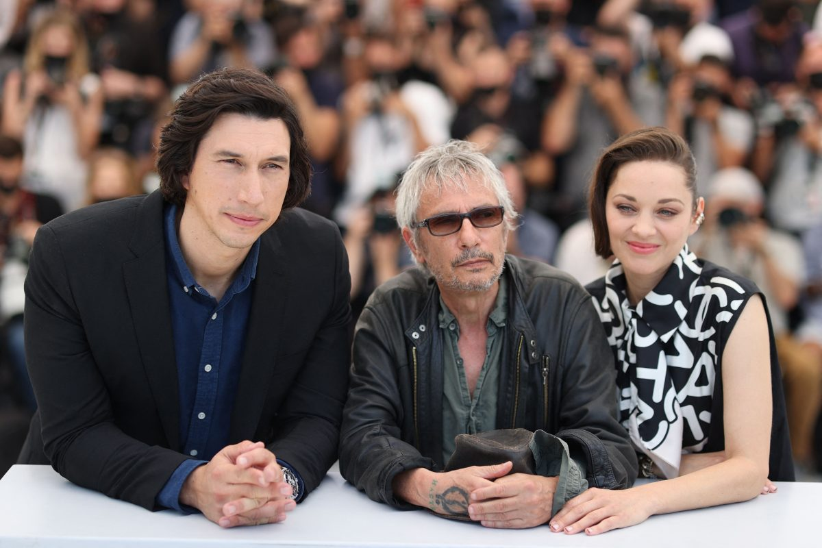 """Adam Driver, Leos Carax, and Marion Cotillard pose during a photocall for the film """"Annette"""" at the 74th edition of the Cannes Film Festival"""