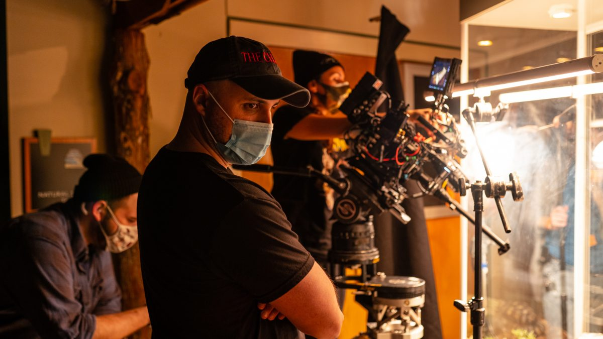 Adam Sigal of 'The Chariot' wearing a mask on set