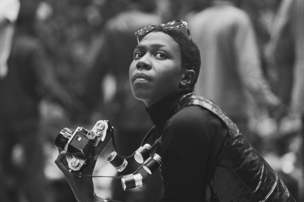 Political & social activist and Black Panther member Afeni Shakur holds a camera as she attends a session of the Revolutionary People's Constitutional Convention, Philadelphia, Pennsylvania, between September 4 and 7, 1970