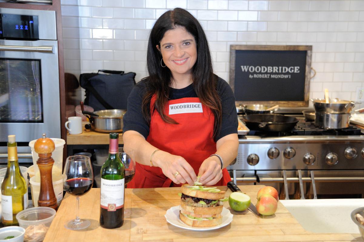 Food Network chef Alex Guarnaschelli prepares a double-decker sandwich, 2016.