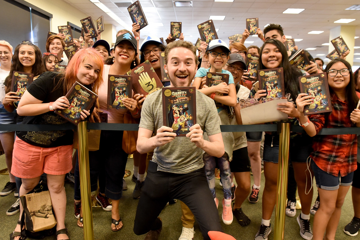 Alex Hirsch poses with fans at 'Gravity Falls' book signing.