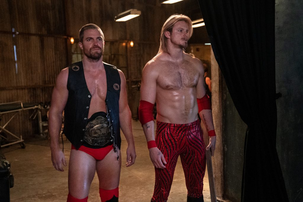 Alexander Ludwig and Stephen Amell prepare to enter the ring