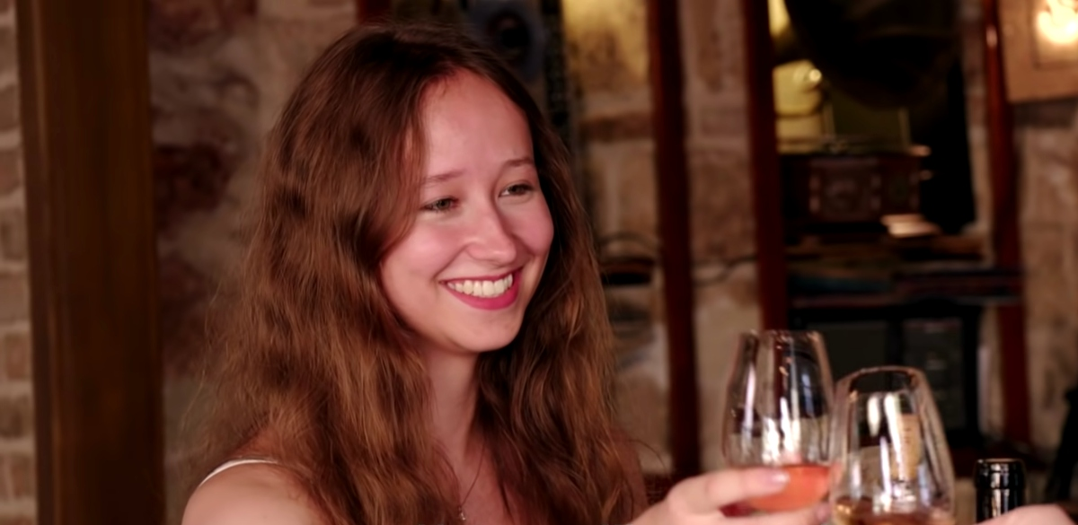 Alina on '90 Day Fiancé: The Other Way,' clinking wine glasses with Steven, who is off camera