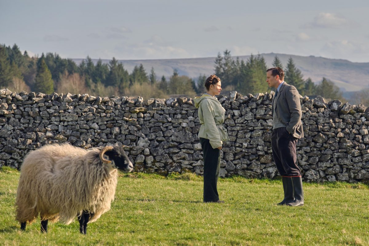 Helen and James standing in a field in 'All Creatures Great and Small' Season 2