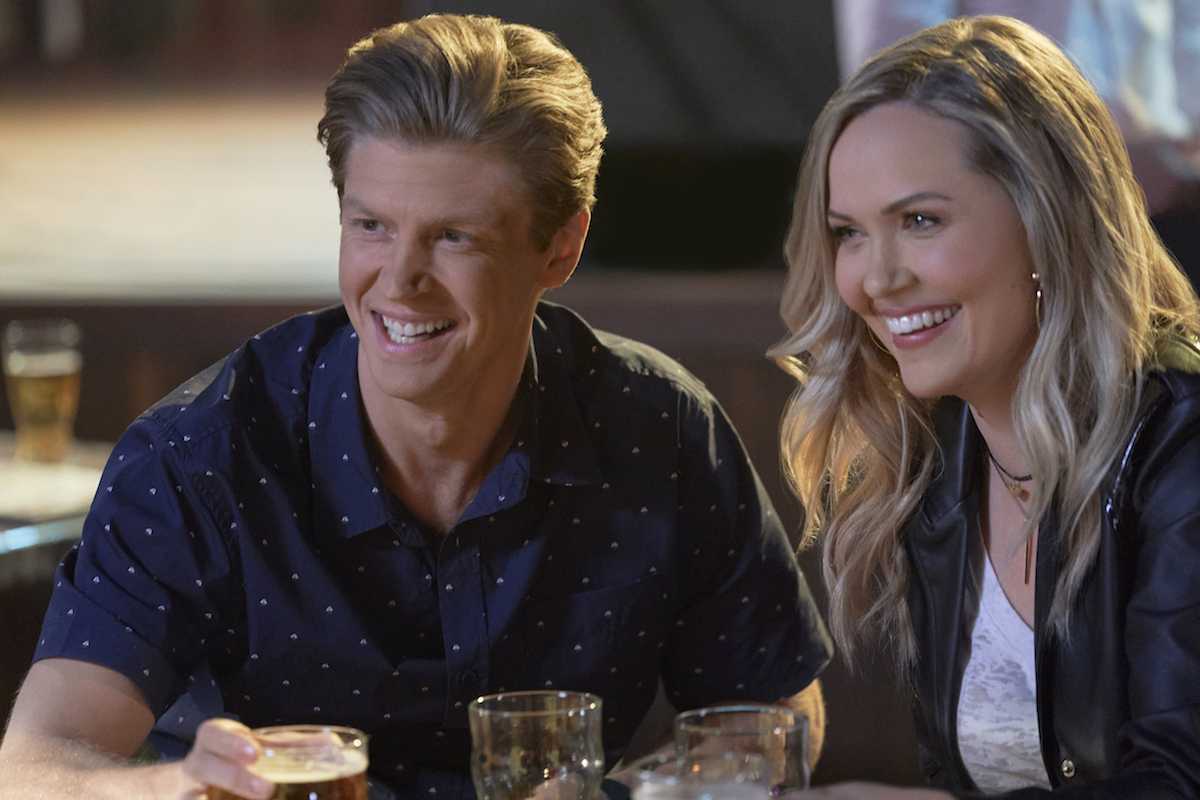 Smiling Andrew Francis and Emilie Ullerup in 'Chesapeake Shores' Season 5