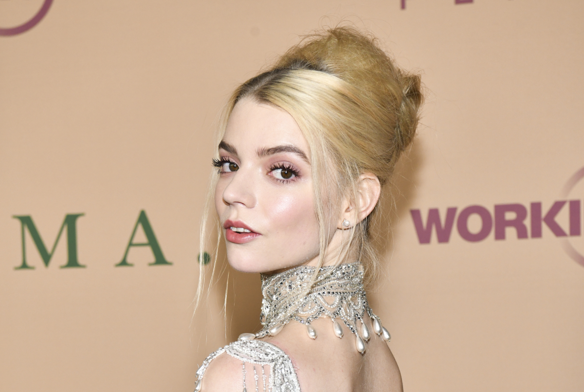 Anya Taylor-Joy in a silver dress with blonde hair in an up-do.