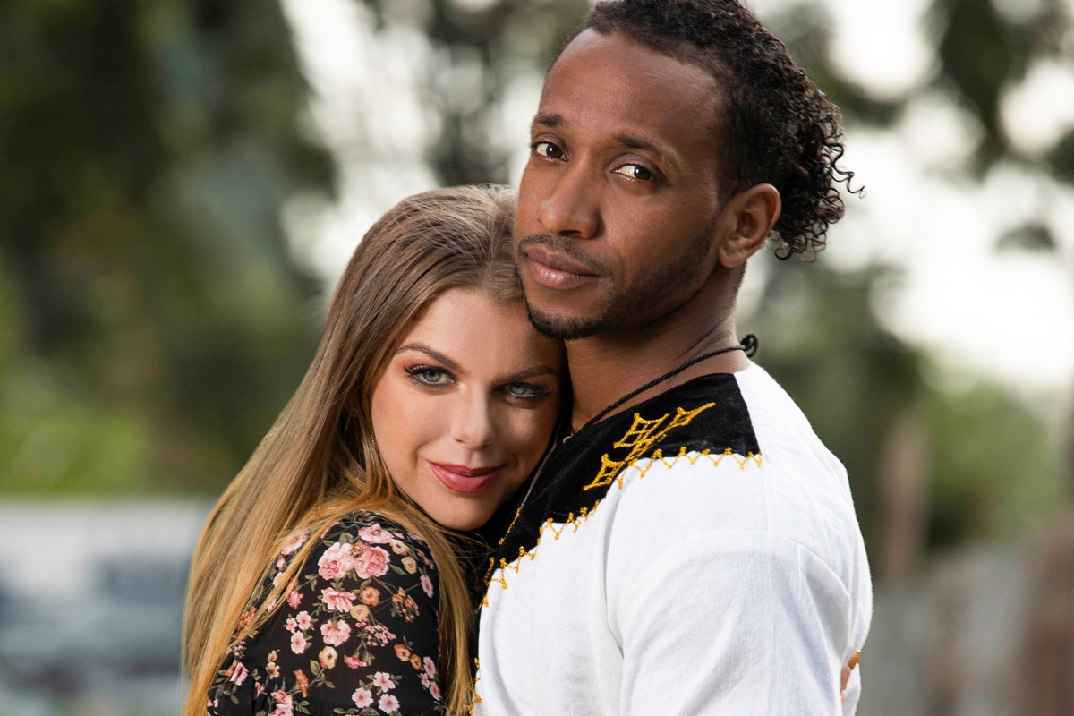 Ariela and Biniyam on '90 Day Fiancé', Ariela Danielle rests her head on Biniyam Shibre's chest as they look at the camera