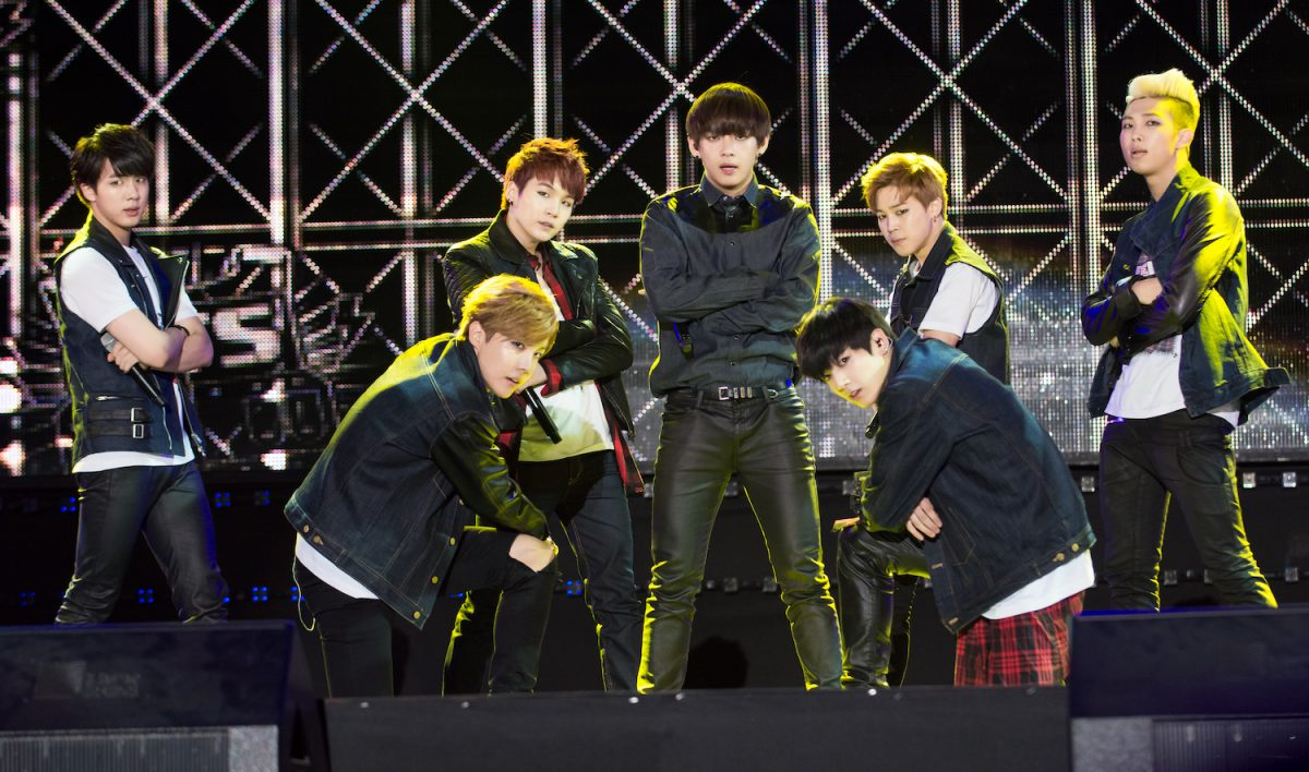 BTS members RM, Suga, J-Hope, Jin, V, Jimin, and Jungkook perform on stage