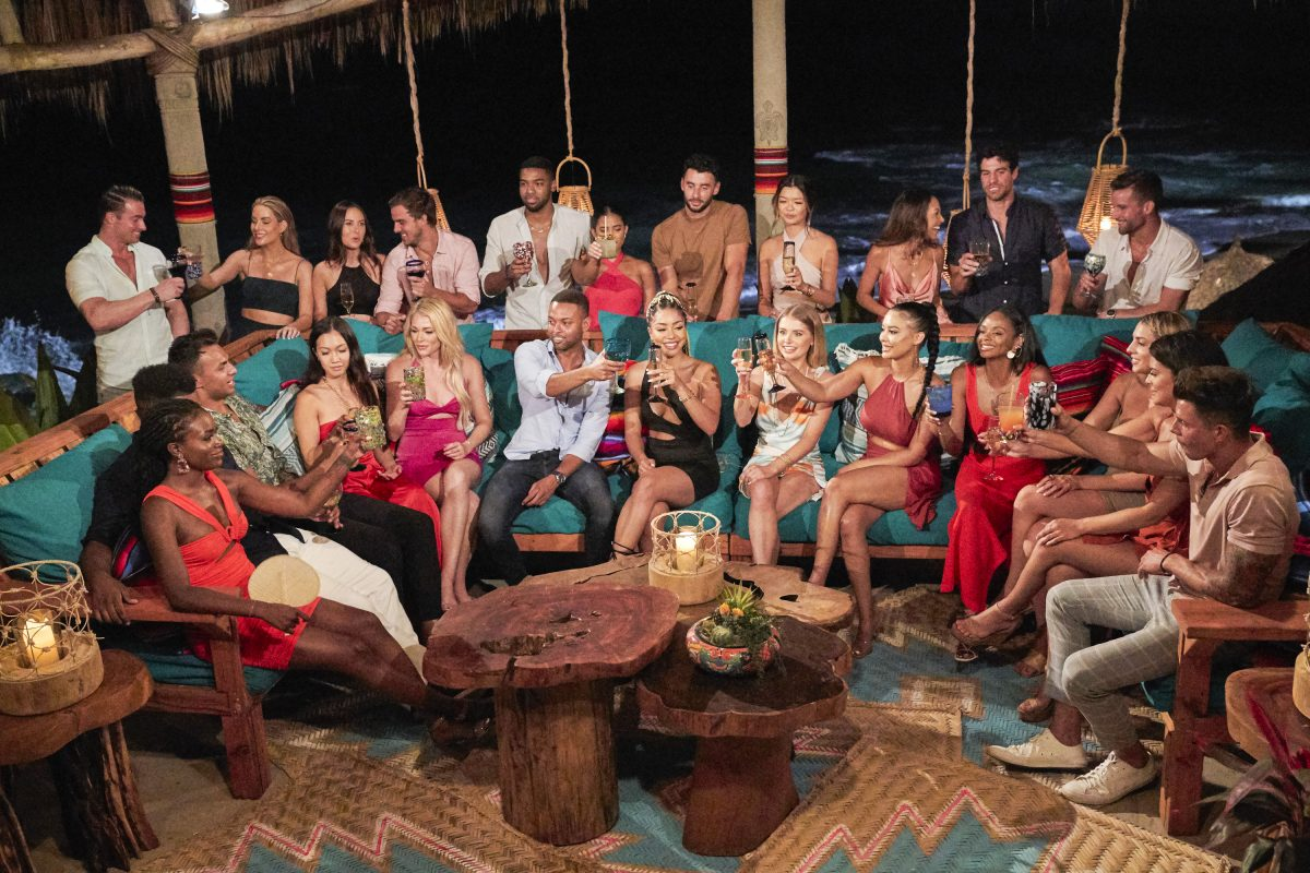 The cast of 'Bachelor in Paradise' lift their drinks in a toat.