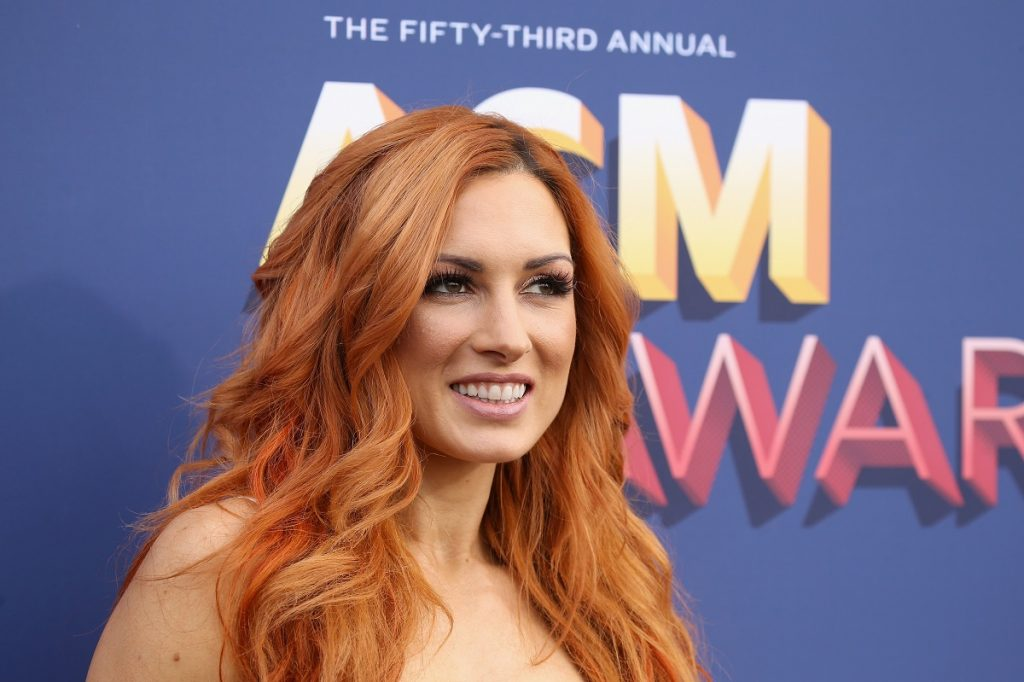 WWE star Becky Lynch wears a white dress at the 2018 Academy of Country Music Awards in Las Vegas.