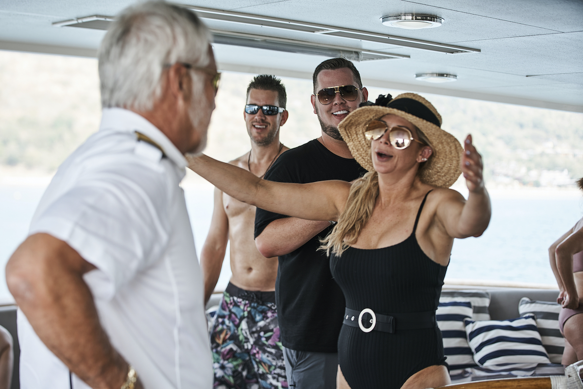 Captain Lee Rosbach from Below Deck comes in for a hug from Alexis Bellino from RHOC