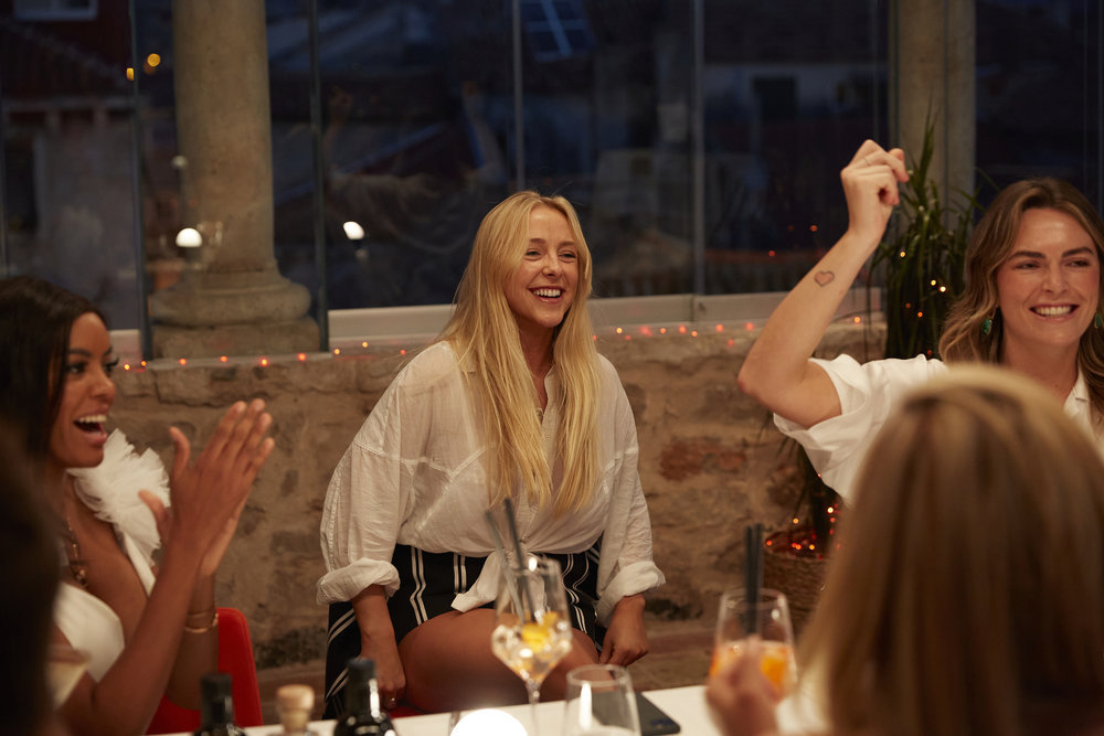 Lexi Wilson, Courtney Veale, and Katie Flood at dinner with the Below Deck Mediterranean crew