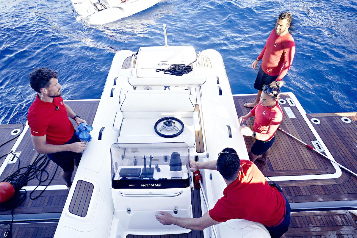 Malia White gives direction to the Below Deck Mediterranean Season 5 deck crew, Robert Westergaard, Alex Radcliffe, and Pete Hunziker