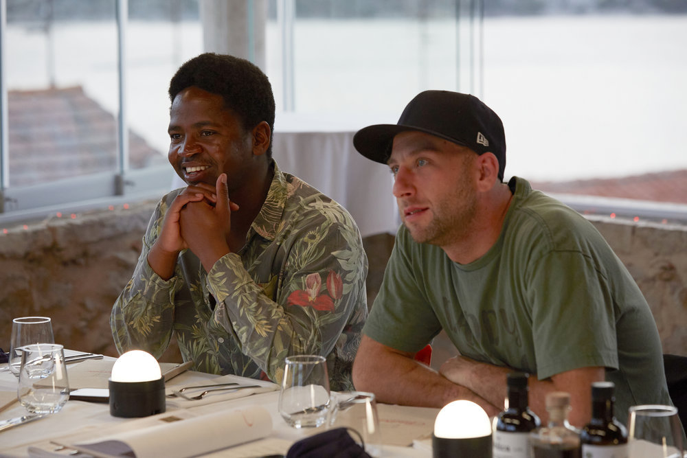 Below Deck Mediterranean's Mzi Zee Dempers and Chef Mathew Shea at dinner with the crew