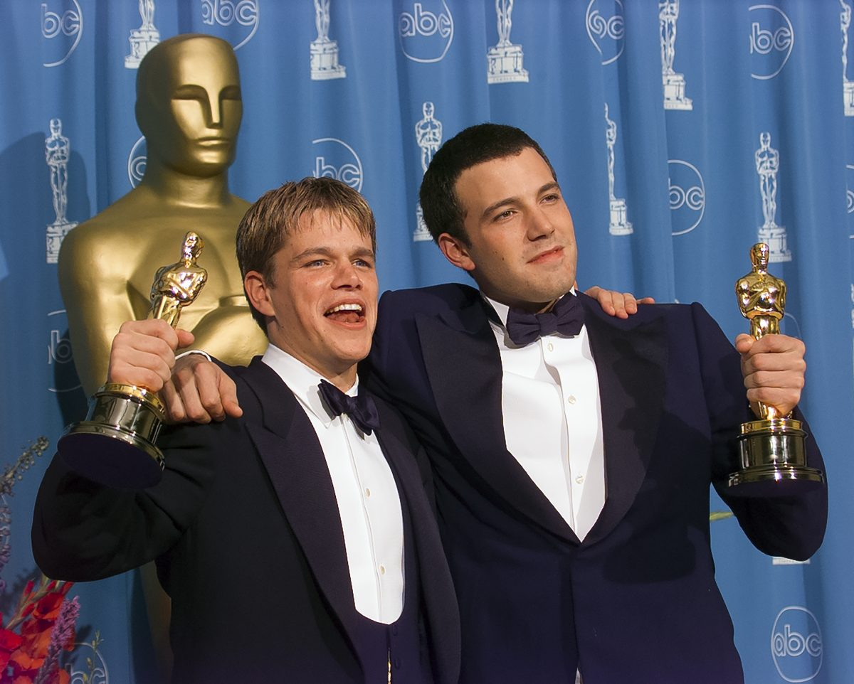 Matt Damon and Ben Affleck embracing each other while accepting their Oscars for 'Good Will Hunting.'