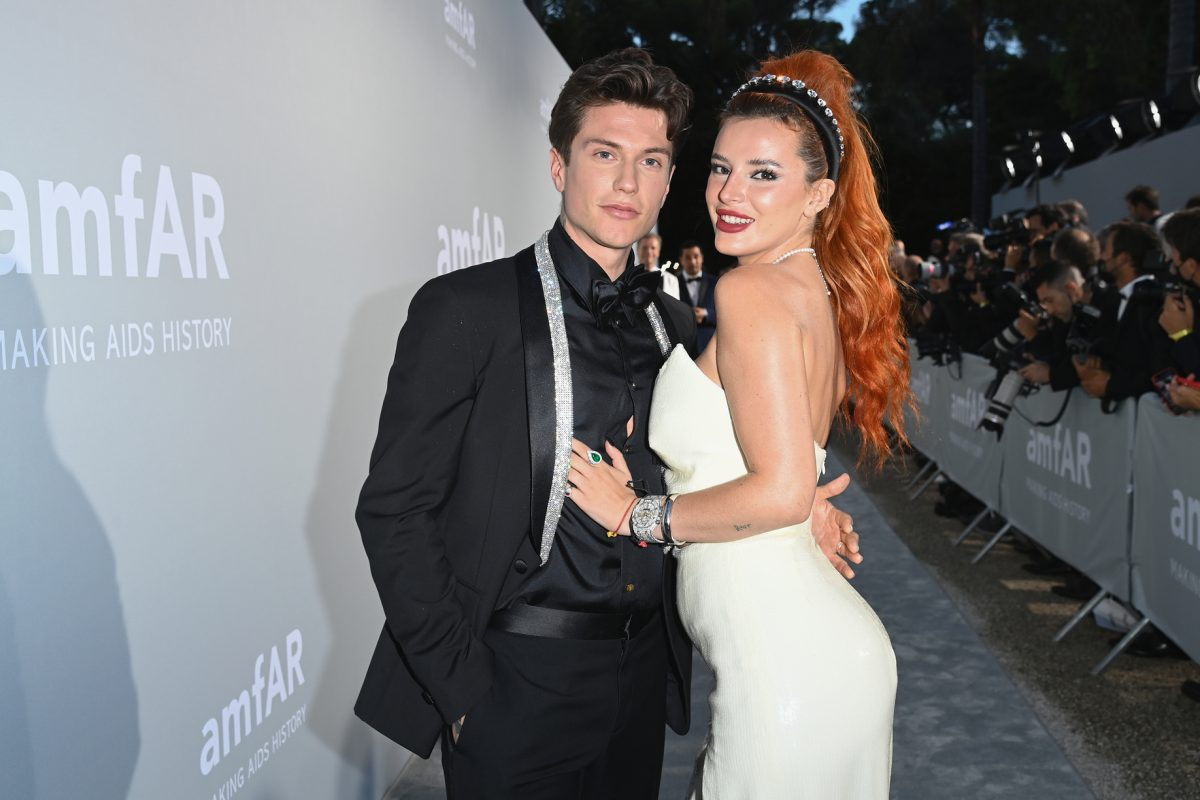 Benjamin Mascolo and Bella Thorne 'Time Is Up' waering blax suit and white dress