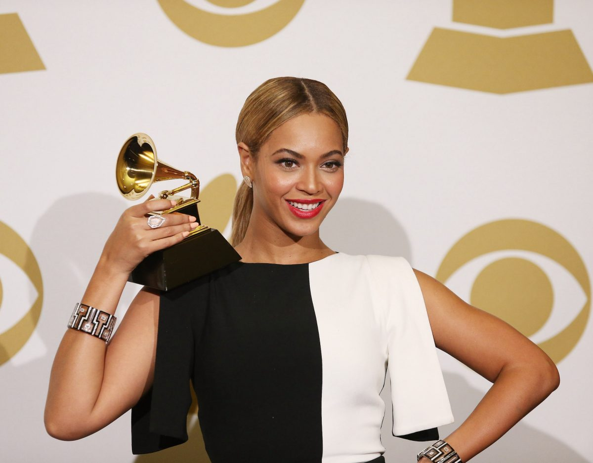 Beyoncé posing with a Grammy at the 55th Grammy Awards in 2013