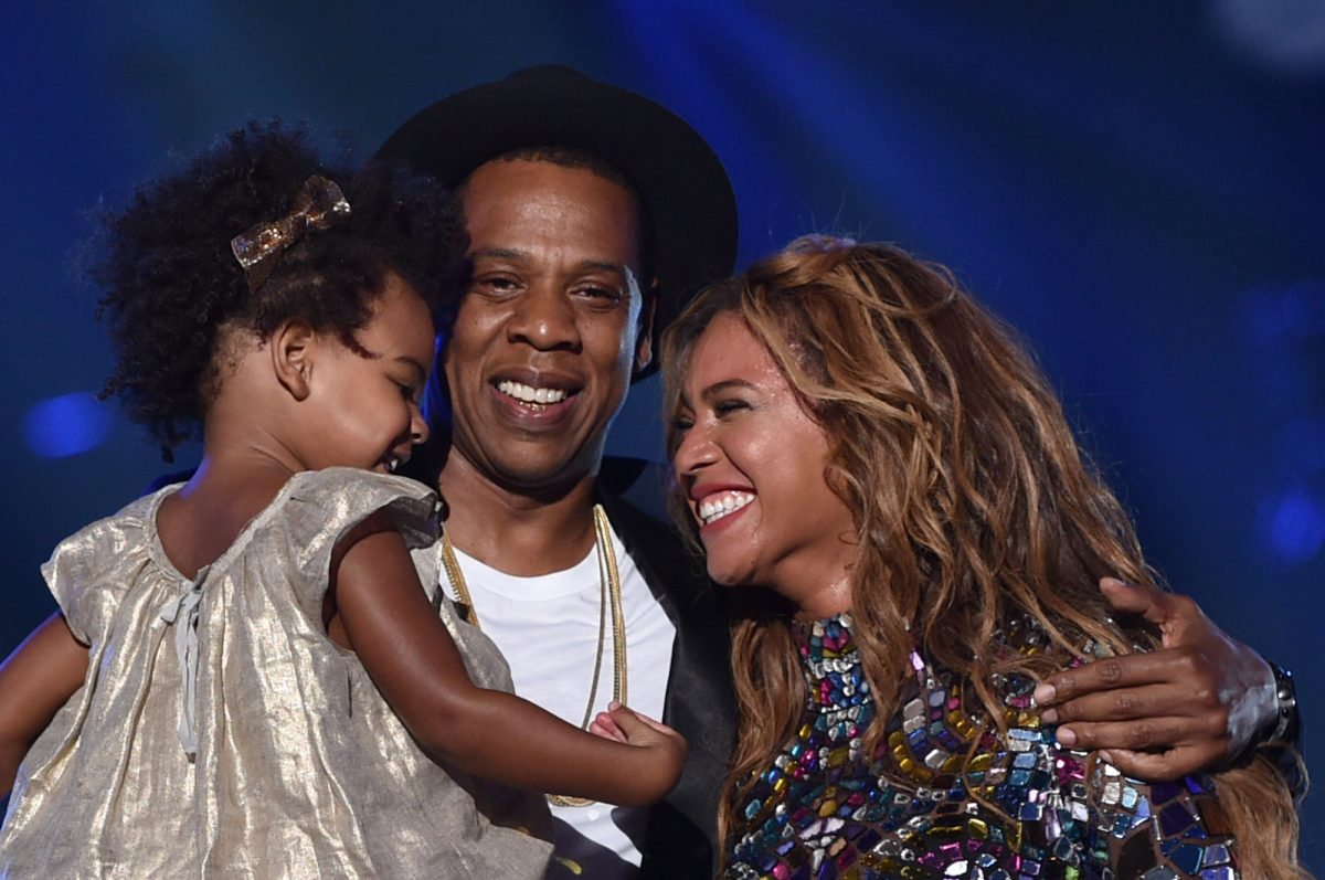 Blue Ivy Carter, Jay-Z, and Beyoncé onstage at the 214 MTV Video Music Awards