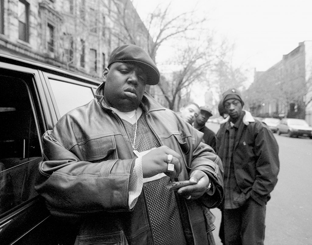 The Notorious B.I.G., aka Biggie Smalls rolls a cigar outside his mother's house in Brooklyn, New York,
