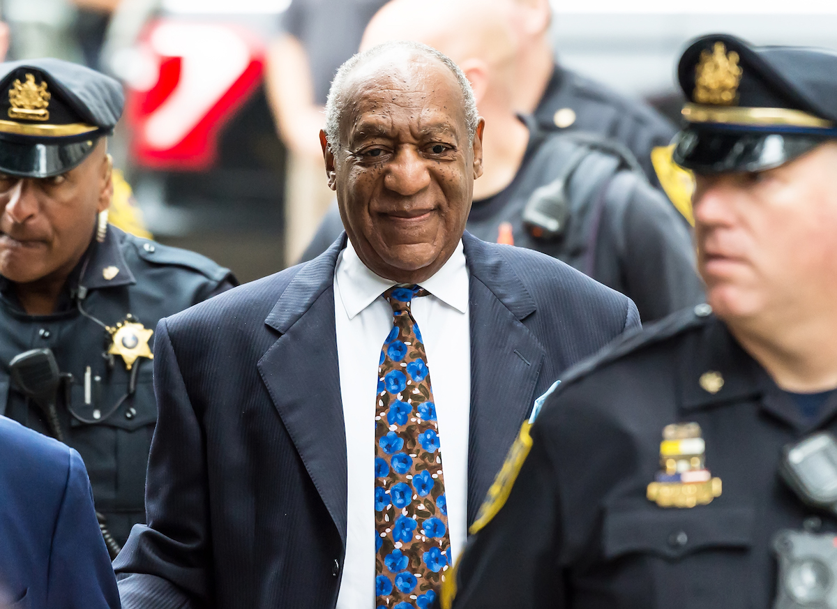 Bill Cosby with police officers