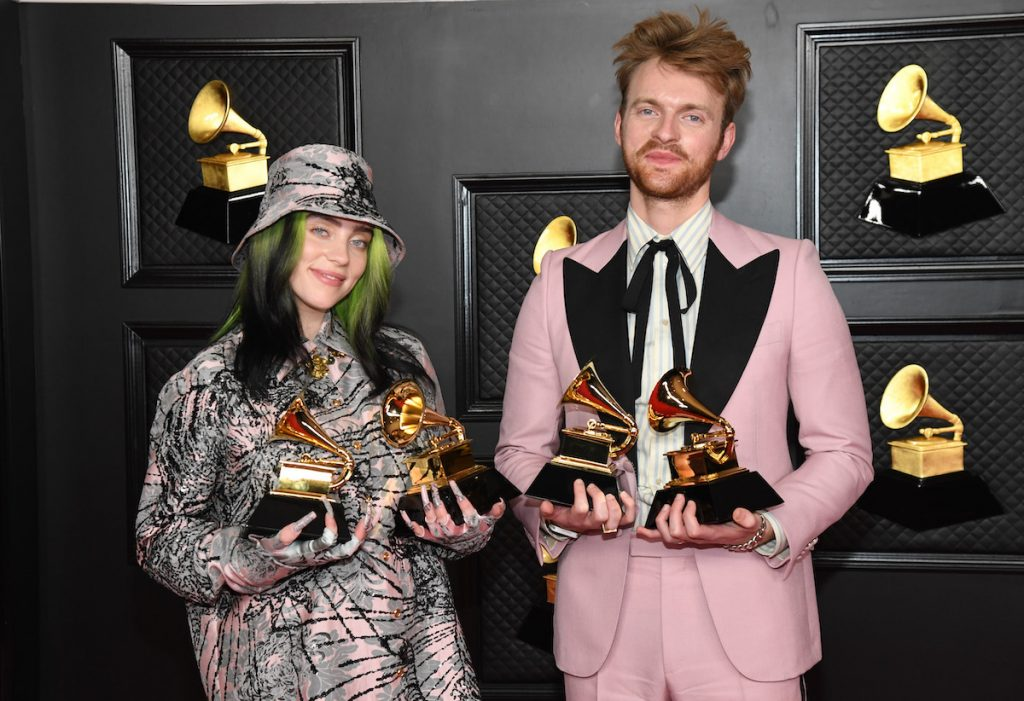 Billie Eilish and her brother Finneas proudly display four Grammy awards.
