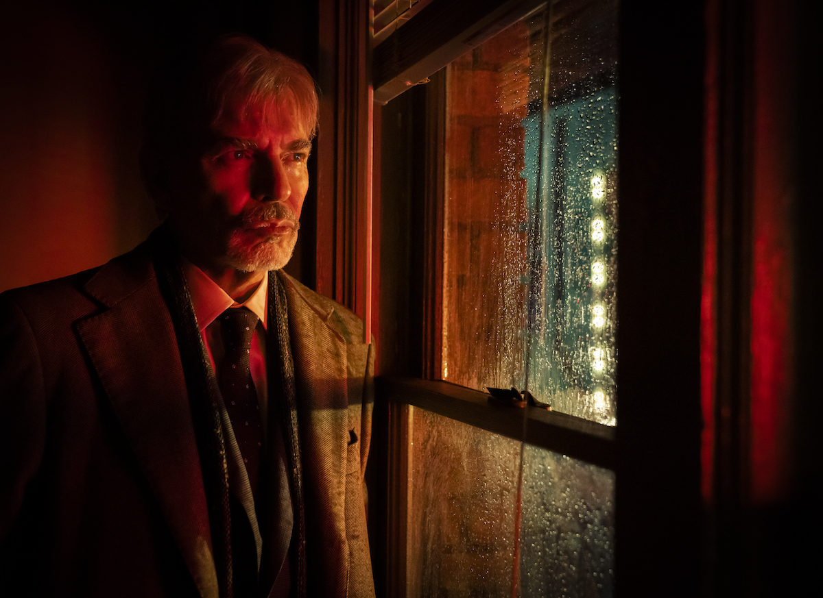 Billy Bob Thornton standing in front of a window in 'Goliath'