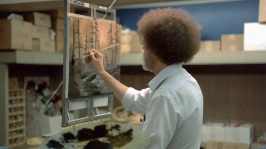 Bob Ross painting a picture in the film 'Bob Ross: Happy Accidents, Betrayal & Greed'