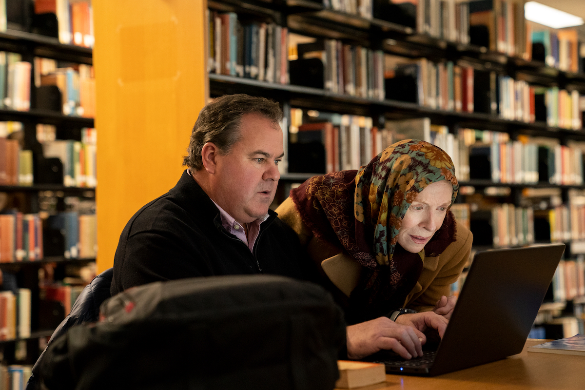 Bob Stephenson and Holland Taylor look at a laptop in 'The Chair' Season 1
