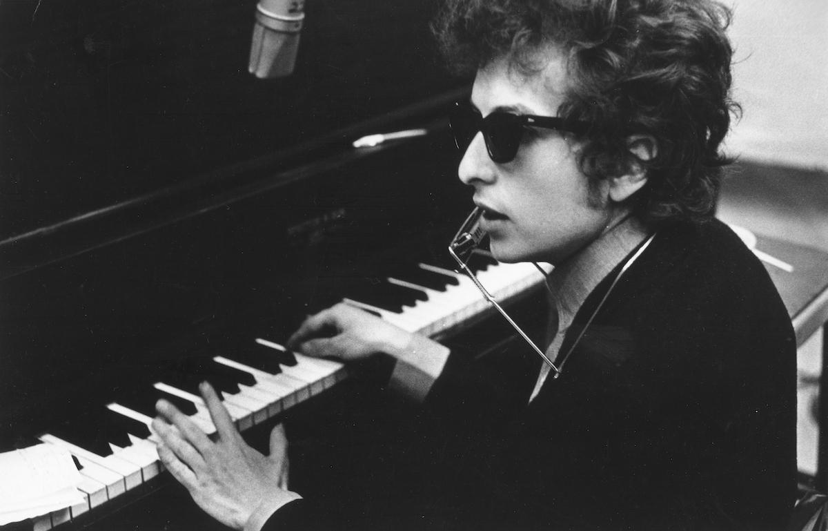 Bob Dylan in sunglasses at piano