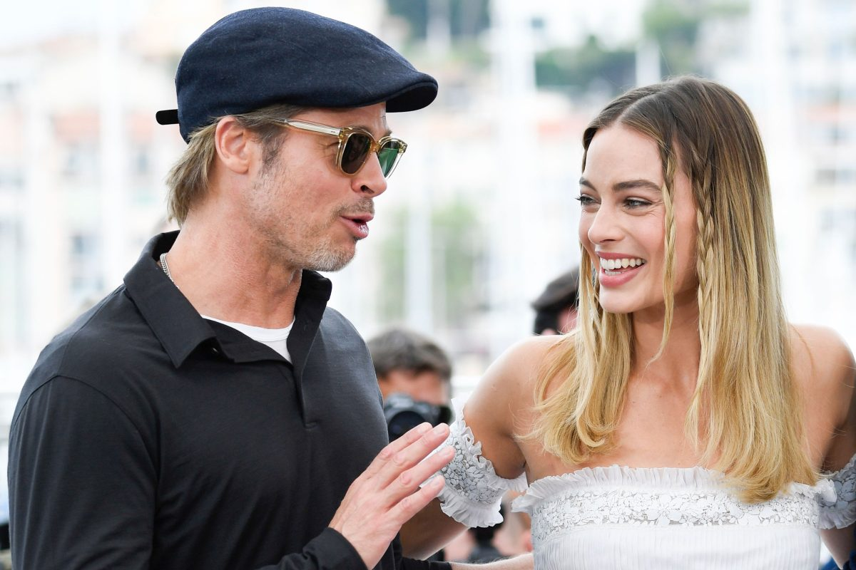 Brad Pitt and Margot Robbie smiling at Cannes Festival for Once Upon a Time in Hollywood