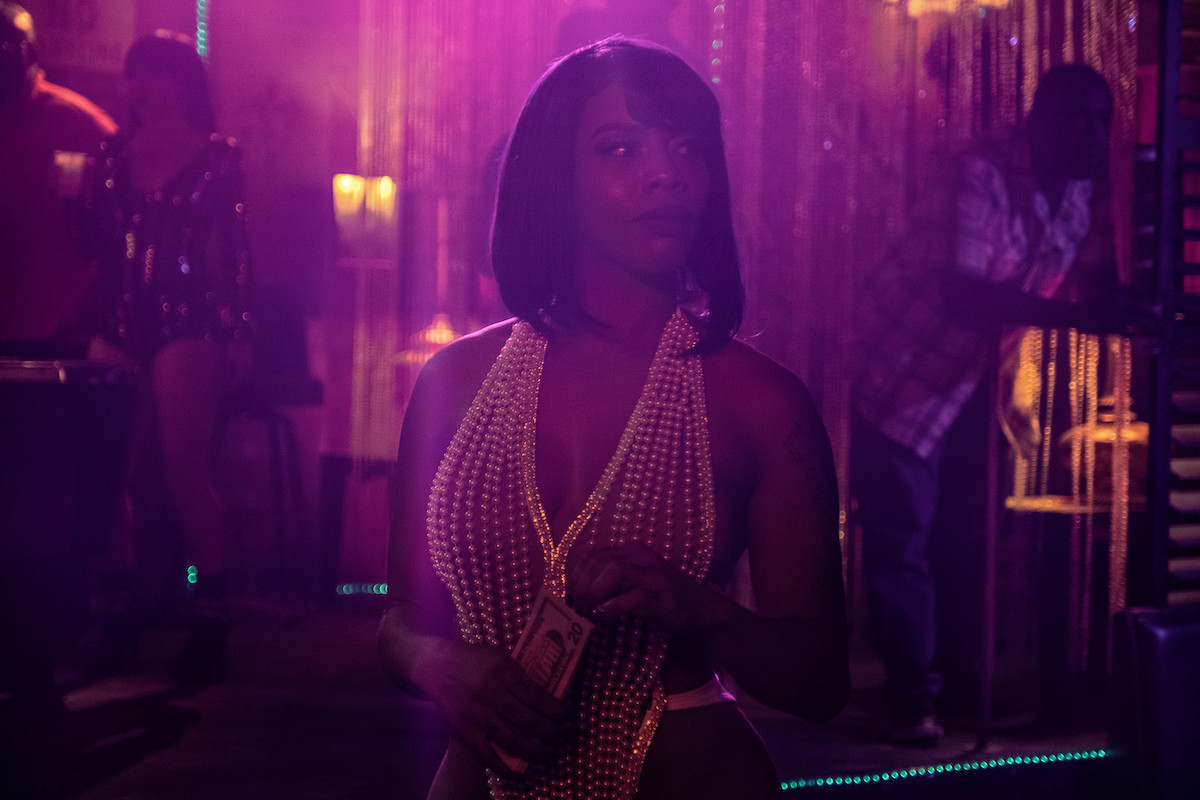 Brandee Evans as Mercedes dressed in a pearls and holding cash in 'P-Valley'