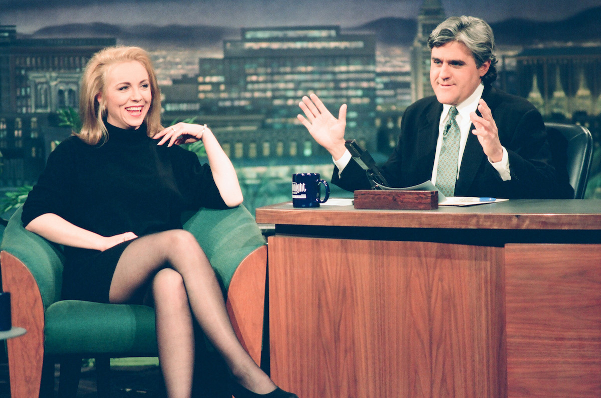 Brett Butler and Jay Leno sitting on couches