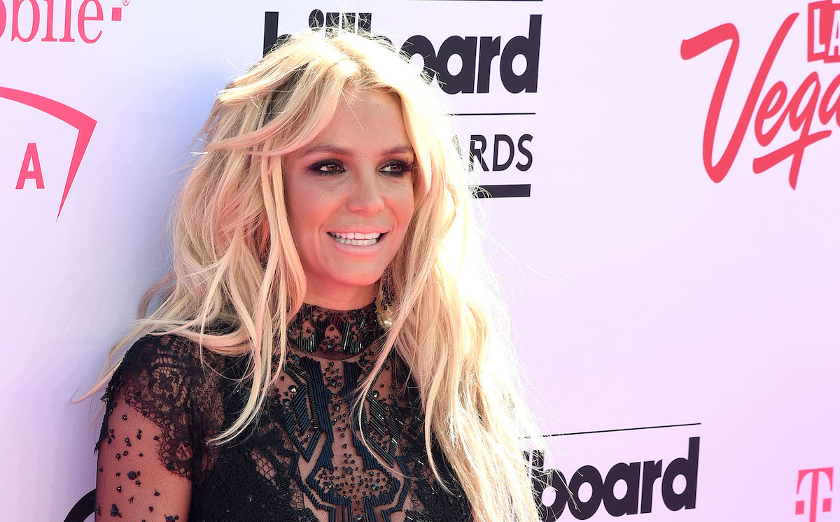 Britney Spears smiling in front of step and repeat