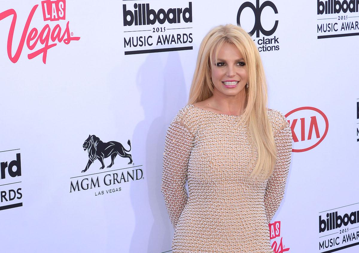 Britney Spears in beige dress