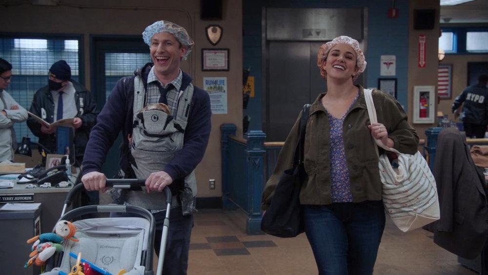 Jake and Amy walk through the precinct with shower caps on in season 8 of 'Brooklyn Nine-Nine'