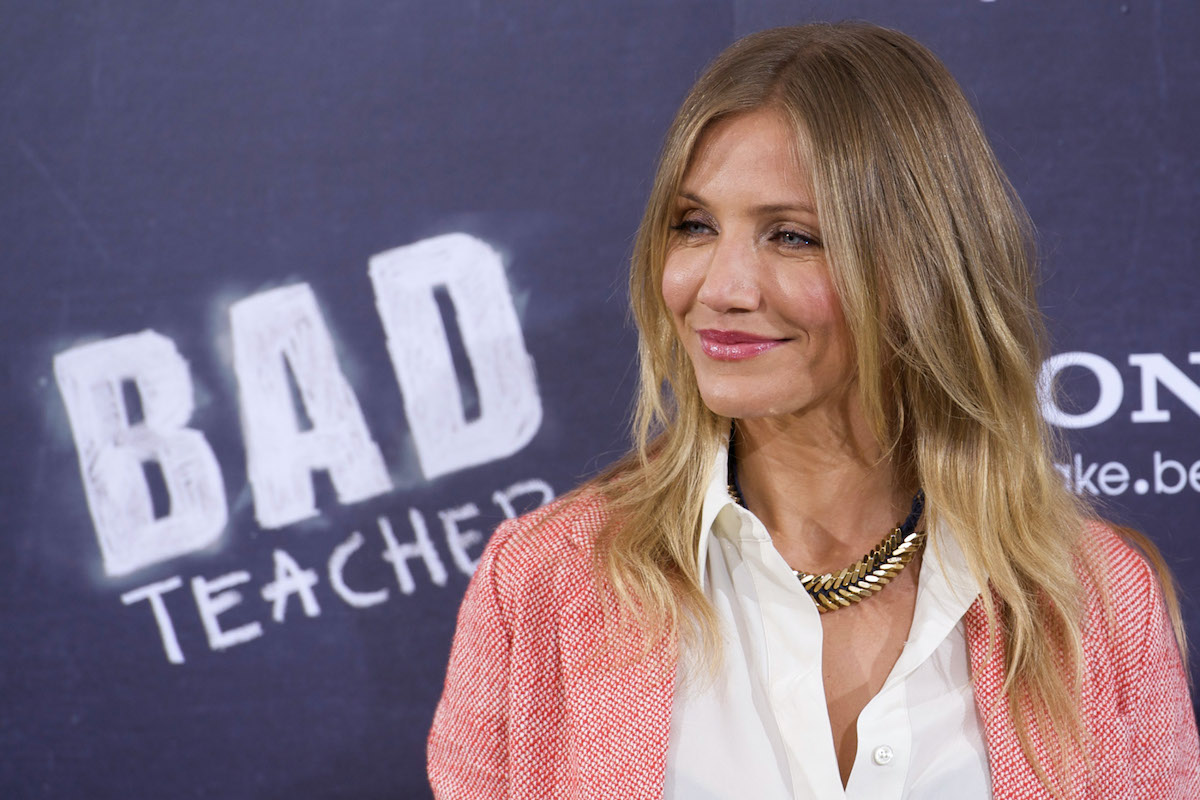 Cameron Diaz smiles and poses in front of the 'Bad Teacher' logo