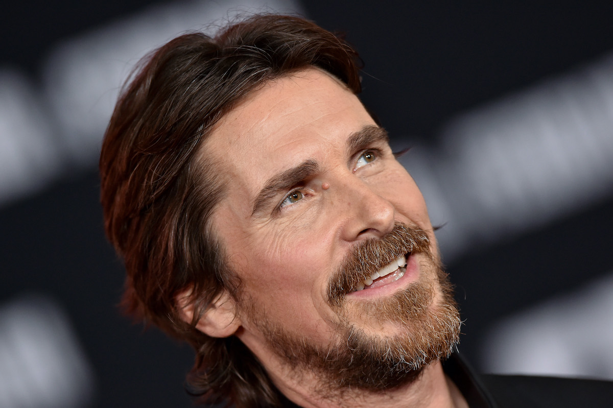 Christian Bale wears black and smiles on the red carpet