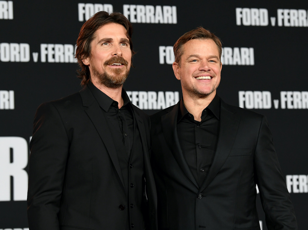 Christian Bale and Matt Damon smile and pose on the red carpet