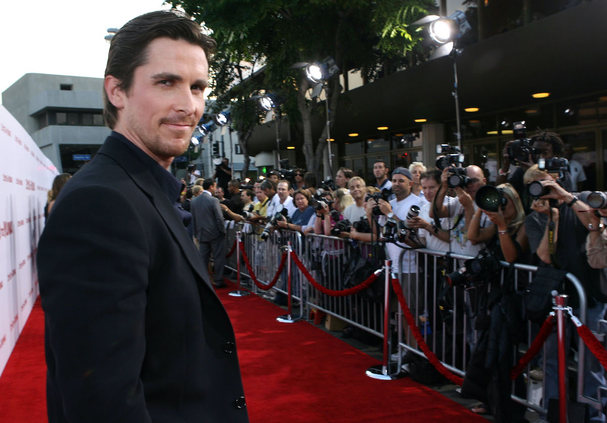 Christian Bale smiles and poses on the red carpet