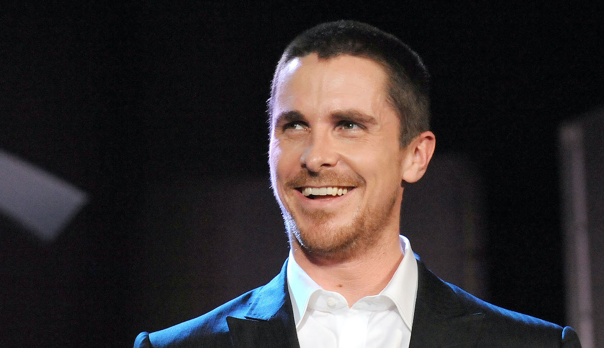 Christian Bale wears black and smiles