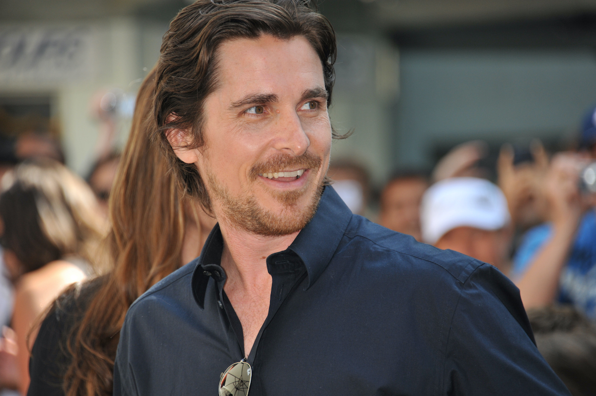 Christian Bale turns and smiles on the red carpet